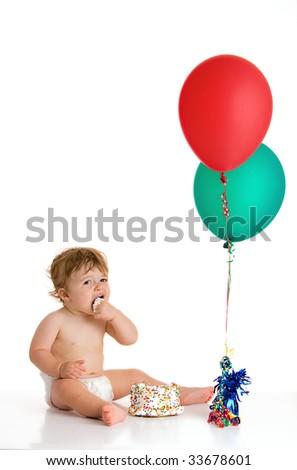 baby boy eating cake - stock photo