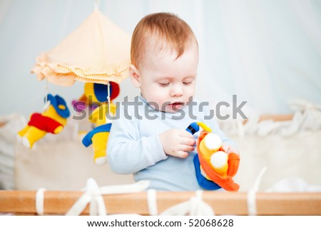baby boy exploring toy - stock photo