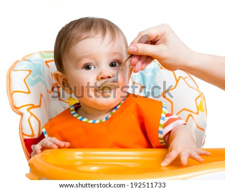 baby boy feeding with a spoon - stock photo