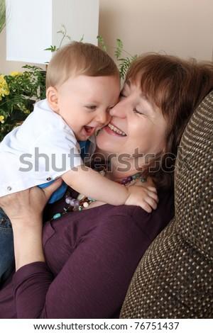 Baby boy giving his grandmother a hug - stock photo
