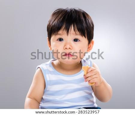 Baby boy having his finger food - stock photo
