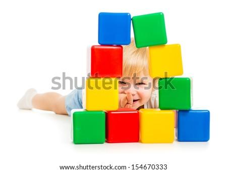 baby boy hidden behind building blocks - stock photo