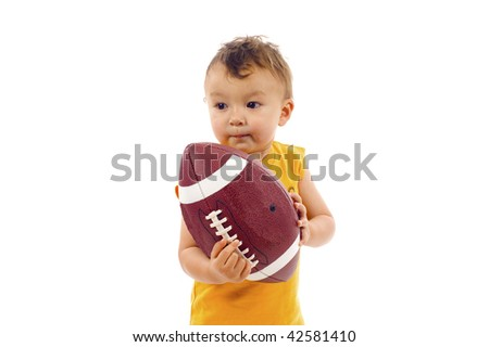 Baby Boy Holding a Football, Ready to Play Ball - Isolated over a white background - stock photo