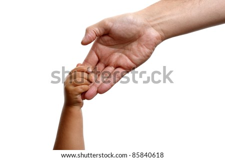 Baby boy holds the hand of his father - stock photo