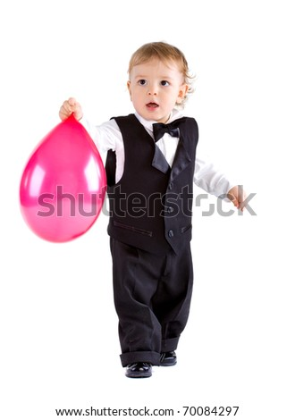 Baby boy in age one year holding balloon - stock photo