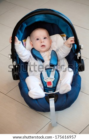 Baby boy in Car Seat - stock photo