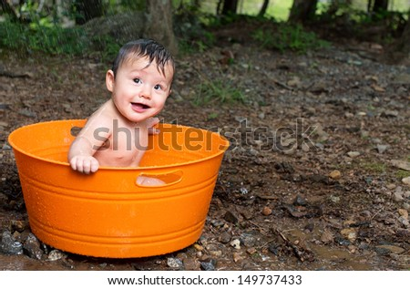 Baby boy in Tub Bathing taking shower outdoors - stock photo