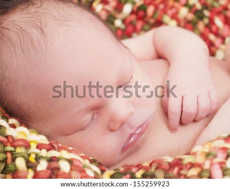 Baby boy is sleeping in the blanket - stock photo