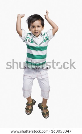 Baby boy jumping and smiling - stock photo