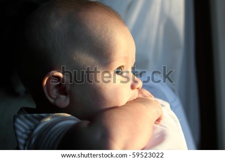 Baby boy looking - stock photo