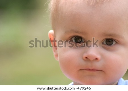 baby boy looking (off centered) - stock photo