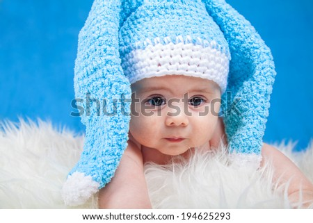 baby boy on blue laughing - stock photo
