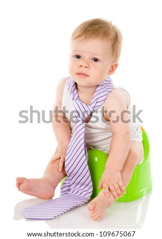 baby boy on chamberpot . isolated on white background - stock photo