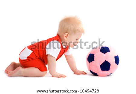 Baby boy playing football isolated on white - stock photo