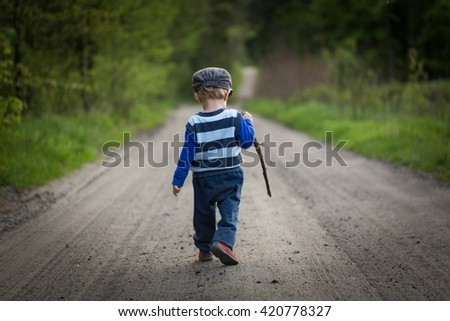 Baby boy playing in forest at spring afternoon. Happy childhood - stock photo