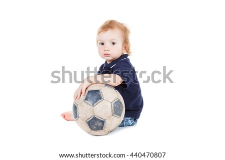 Baby boy playing with a soccer ball. Isolated on white background - stock photo