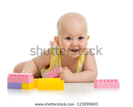 baby boy playing with construction set isolated on white background - stock photo