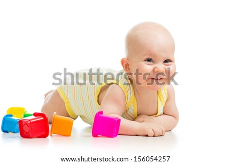 baby boy playing with cup toys - stock photo