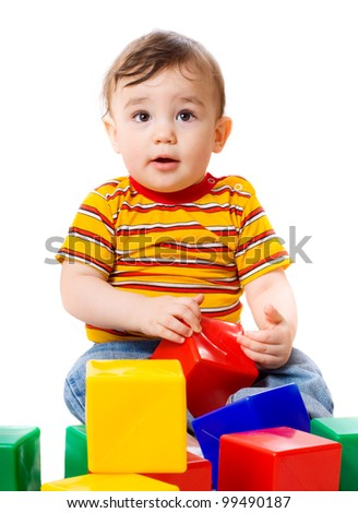 Baby boy plays with toy blocks isolated on white background - stock photo