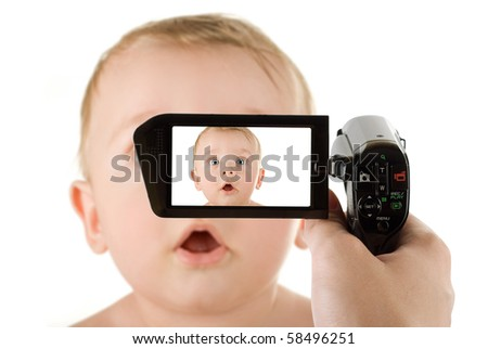 baby boy portrait closeup isolated on a white background recording by camcorder - stock photo