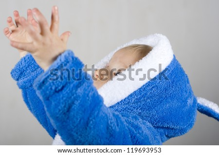 Baby boy reaching for something - stock photo