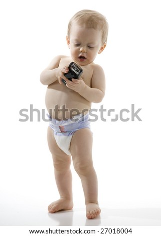 Baby Boy sending Text message on Cell Phone - stock photo