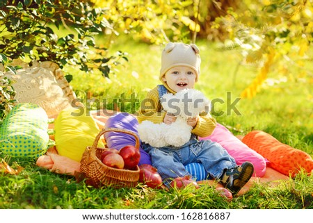 baby boy sitting on the sunny meadow - stock photo