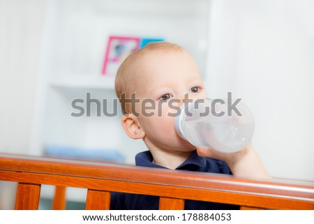 Baby Boy Standing in the crib - stock photo