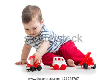 baby boy toddler playing with toy ambulance car - stock photo