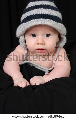 Baby boy wearing a knitted hat. - stock photo