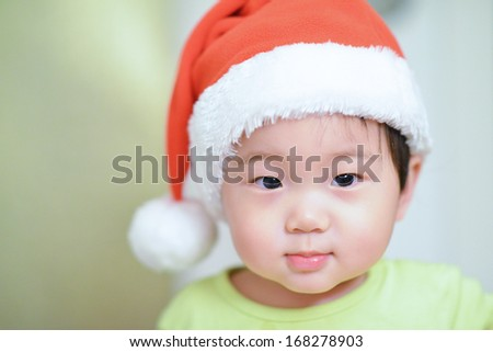 baby boy wearing christmas cap  - stock photo