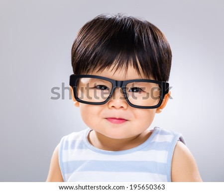 Baby boy wearing glasses - stock photo