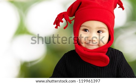 Baby Boy Wearing Warm Clothing, Outdoors - stock photo
