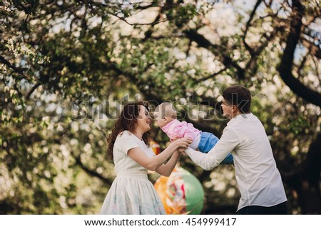 Baby boy with his parents in the nature - stock photo