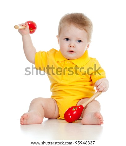 Baby  boy with musical toys. Isolated on white background - stock photo