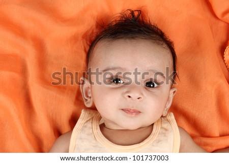 Baby boy with orange background - stock photo