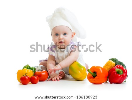 baby chef with healthy  food vegetables - stock photo