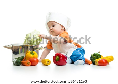 baby chef with healthy  food vegetables and pan - stock photo