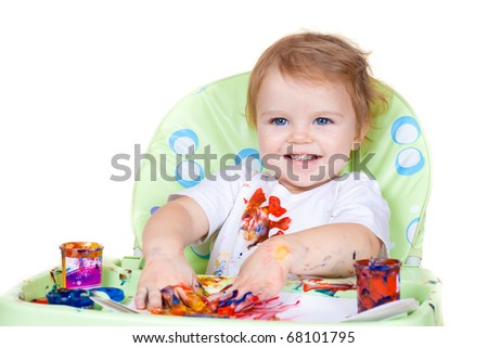 baby child creates art picture with paints as artist (#4 from series) - stock photo