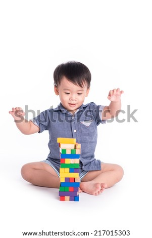 Baby child playing with construction blocks. kid playing toy blocks - stock photo