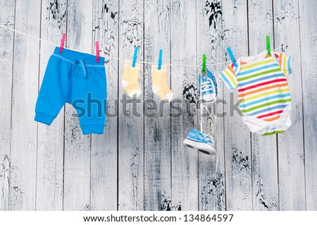 Baby clothes hanging on the clothesline. - stock photo