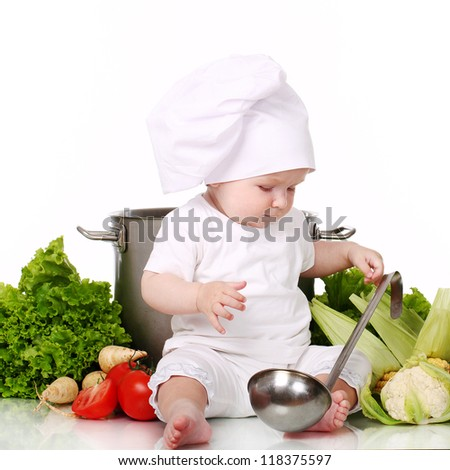Baby cook with pan and vegetables isolated on a white - stock photo