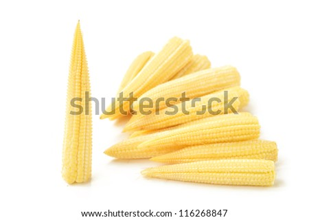 Baby corn on a white background, close-up - stock photo
