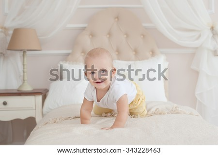 baby crawling on the bed - stock photo