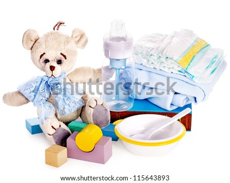 Baby diaper and toys with teddy bear . Isolated. - stock photo
