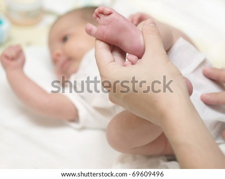 Baby diaper changing - stock photo