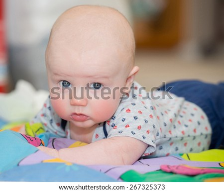 Baby does tummy time! - stock photo