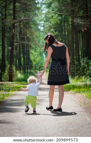 Baby doing first steps - stock photo