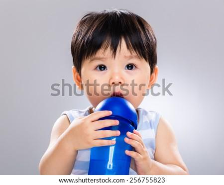 Baby drinking water - stock photo