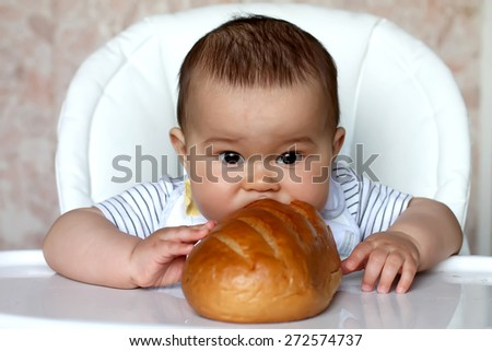 Baby eat bread - stock photo